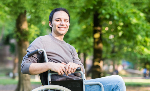 Portrait of a smiling man on a wheelchair