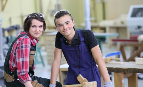 Portrait of young apprentices in carpentry school